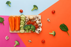 Cut raw vegetables on wooden board, healthy food. Healthy eating, vegetarian diet background. Vegetable food, copy space. Ingredients for salad or soup Stock Photo