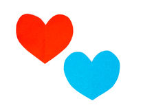 Cut red and blue paper hearts together on white background Stock Images