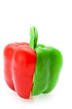 The cut red and green pepper Stock Photos