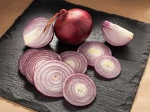 Cut red onion on a chopping board Stock Photos