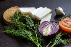 Cut red onions, tomato, dill, lard salo and garlic on  wooden table Stock Photography