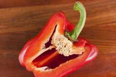 Cut red pepper. Visible grains of pepper. Lying cut on a chopping Board red pepper. Visible grains of pepper Stock Photo