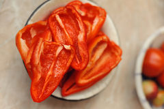 Cut red peppers into plate Stock Image