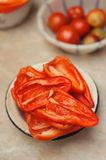 Cut red peppers into plate Royalty Free Stock Image
