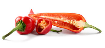 Cut red peppers on a white background. Cut fresh red peppers on a white background Royalty Free Stock Photo