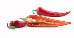 Cut red peppers on a white background. Cut fresh red peppers on a white background Stock Photo