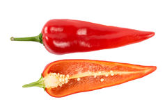 Cut red peppers on a white background Stock Photo