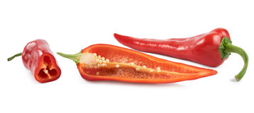 Cut red peppers on a white background Royalty Free Stock Image