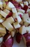 Cut red potatoes Stock Photography