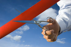 Cut of the red ribbon Stock Photos
