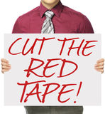 Cut The Red Tape. A man holding a poster indicating Cut The Red Tape Stock Images