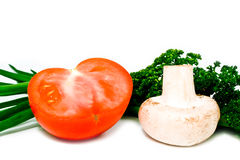 Cut red tomato spring onions and mushroom Royalty Free Stock Image
