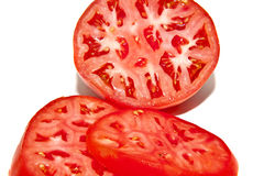 Cut Red Tomatoes Stock Images