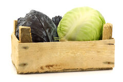 Cut red and white  cabbage in a wooden box Stock Photos