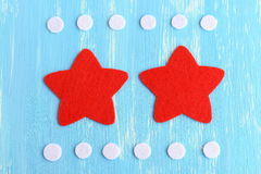 Cut red and white felt details to create Christmas star decor. Step-by-step. Christmas star tutorial. Top view. Closeup Stock Photo