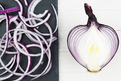 Cut in rings, slices of purple onion. Fresh red onion royalty free stock image