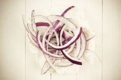 Cut in rings, slices of purple onion. Fresh red onion royalty free stock photo