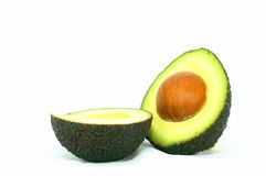 Cut ripe Avocado. On it's side, isolated white background stock photography