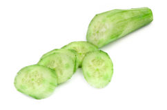 Cut ripe cucumber on white Stock Image