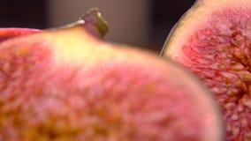Cut ripe figs 4K macro pan shot stock video