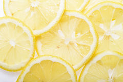 Cut ripe lemon. On white background Royalty Free Stock Photos