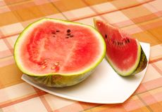 Cut ripe melon. Cut half and  piece of watermelon  on plate Stock Photos