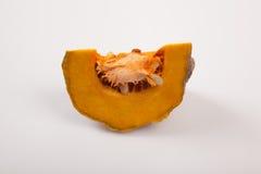 Cut ripe orange pumpkin on white background Stock Photos