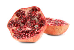 Cut ripe pomegranate fruit on white Royalty Free Stock Photos