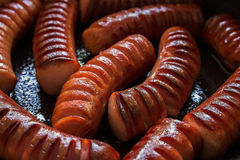 Cut and roasted hot dogs Stock Images