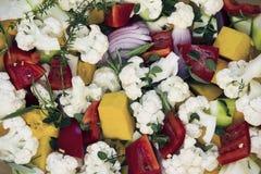 Cut for roasting vegetables - cauliflower, pumpkin, onion, garlic, carrot Stock Photo