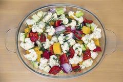 Cut for roasting vegetables - cauliflower, pumpkin, onion, garlic, carrot Royalty Free Stock Photo