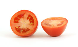 Cut roma tomato. A nice view of a fresh roma tomato cut in half Stock Photography
