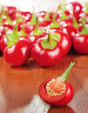 Cut round hot chilly pepper on a table Stock Photography
