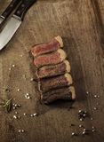 Slices of a grilled beef steak. Barbecue meat. Stock Images