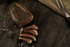 Slices of a grilled beef steak Royalty Free Stock Photo