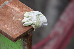 Cut Rusty Metal And Glove Royalty Free Stock Images