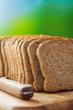 Cut rye bread and knife Stock Photo