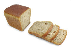 Cut rye bread on white background Stock Images