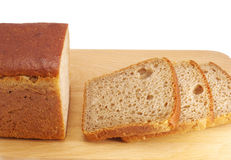 Cut rye bread on wooden board Stock Image