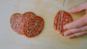Cut salami on the Board.  stock video footage