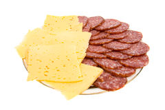 The cut salami and cheese on a plate. Royalty Free Stock Photography
