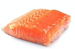 Cut salmon fillet. Surrounded by white background Royalty Free Stock Photo