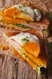 Cut sandwich Croque Madame closeup of paper. Vertical Stock Images