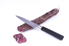 Cut a sapnish sausage. Spanish sausage, typical spanish food Royalty Free Stock Photography