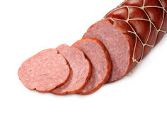 Cut sausage. On a white background Stock Image