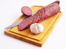 The cut sausage on a white background Royalty Free Stock Images