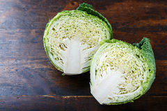 Cut savoy cabbage. On a wooden background, close-up stock images