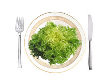 Cut savoy cabbage on plate, fork and knife isolated on white Stock Photo
