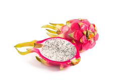 Cut section of dragon fruit and a whole one Royalty Free Stock Photos