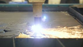 Cut sheet metal. Automation of process. Automatic work for ironwork. Sparks Close up. 4k stock footage